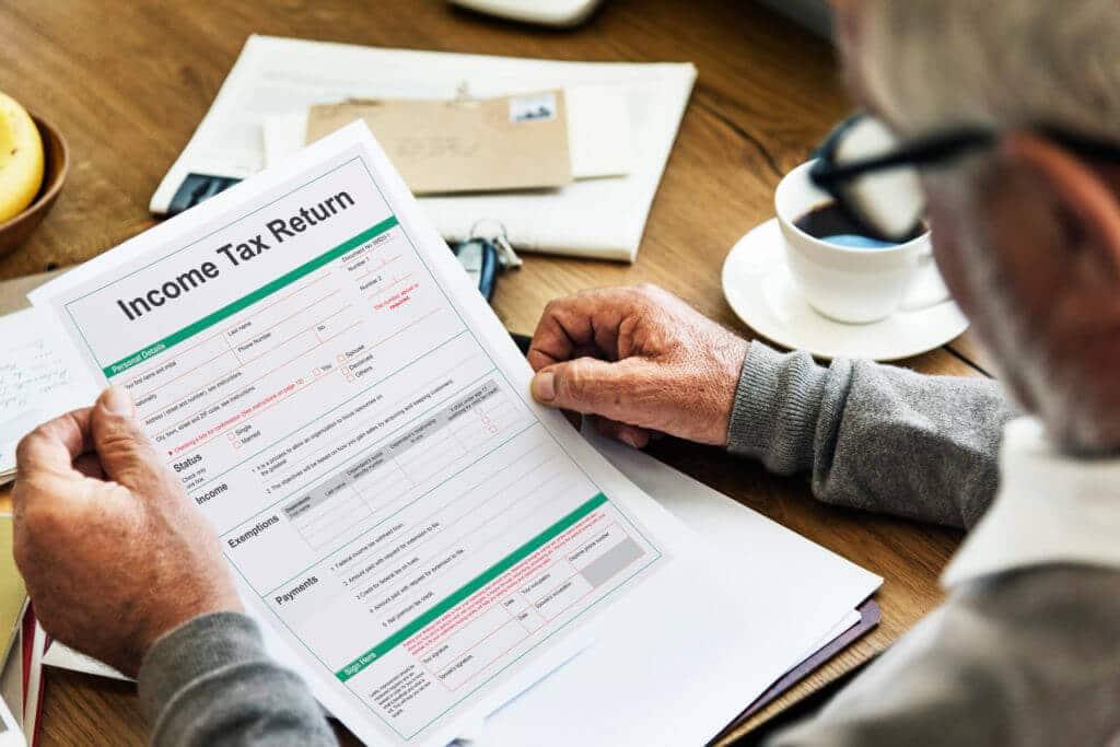 income tax return deduction refund concept PFNXY9G