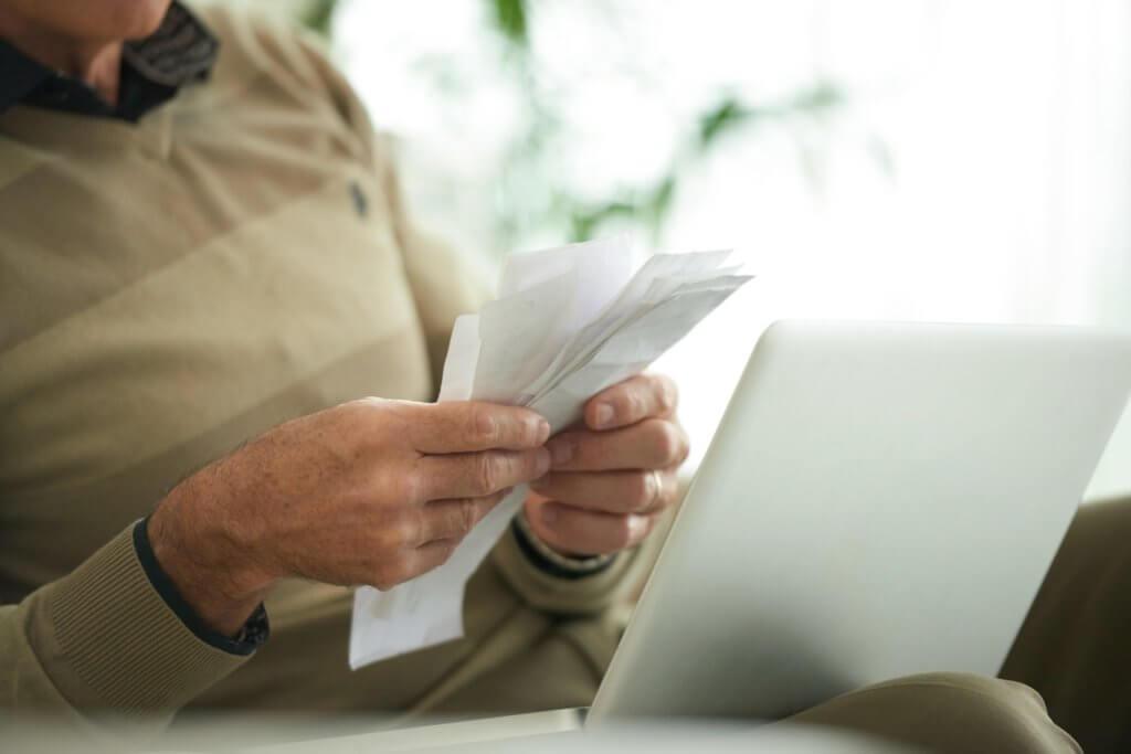 Bills and receipts in hands of senior man